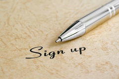 Sign up. Close up of pen on sign up text Stock Images
