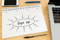 Sign up text concept. Sign up - handwritten text in a notebook on a desk - 3d render illustration Stock Photos