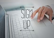 Sign up text against hand on laptop. Digital composite of Sign up text against hand on laptop Royalty Free Stock Photography