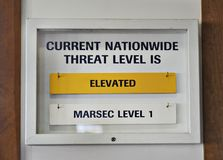 Sign US terrorist threat level elevated yellow. Sign showing nationwide threat level at elevated yellow under Homeland Security Advisory System (HSAS) at the Royalty Free Stock Images