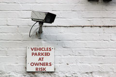 Sign for Vehicles parked at owners risk Royalty Free Stock Image
