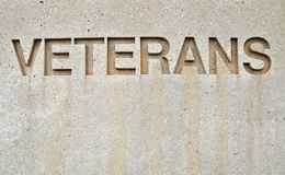 Sign veterans. Veterans sign etched in stone Stock Images