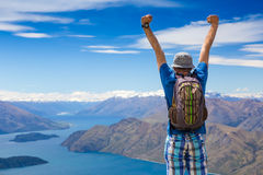 Sign of victory: hiker on the top Stock Image