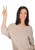 Girl showing victory sign Royalty Free Stock Photography