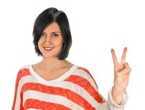 Girl showing victory sign Stock Image