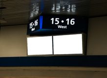 Sign on a wall near the ceiling Top part shows track numbers and the two screens below are blank copy space. Sign on a wall near the ceiling Top part shows royalty free stock images