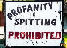 Sign warning against spitting and profanity Stock Photos