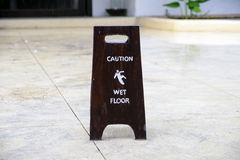 Sign warning of caution wet floor Royalty Free Stock Photo