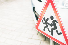 Sign: Warning children on the road. Be carefu. The Sign: Warning children on the road. Be carefu Royalty Free Stock Photo