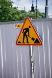 Sign warning for construction. Work in progress triangle shaped sign on a barrier of the TLC construction company in Poznan, Poland Royalty Free Stock Photography