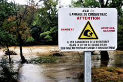 Sign warning of the danger of dam water upstream dropped Stock Image