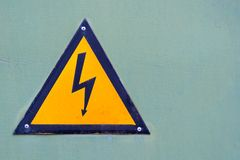 The sign warning about danger of electricity. Royalty Free Stock Photography