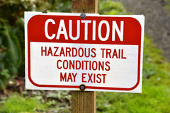 Sign warning of hazardous trail conditions Royalty Free Stock Photos