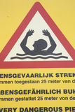 Sign warning people for dangerous swimming situation Stock Image