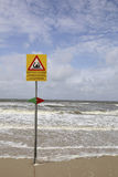 Sign warning people for dangerous swimming situation Stock Photography