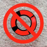 Please do not remove the safety ring. A sign warning people to not remove the lifesaving ring, unless to be used in a rescue. The symbol is a black stencilled stock images