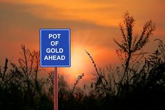 A sign warning Pot of Gold Ahead. Concept for hoe of abundance Stock Image