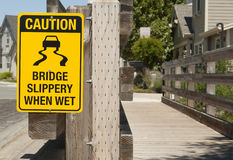 Sign warning of slippery bridge Royalty Free Stock Photo