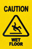 Sign warning for slippery floor when wet Royalty Free Stock Images