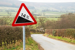 Sign Warning of a Steep HIll Stock Images