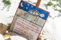 Sign with warning to the care of nests of sea turtles on. Sign with Spanish warning to the care of nests of sea turtles on Floreana, Galapagos, Ecuador Royalty Free Stock Image