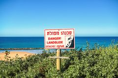 Sign that warns about the danger ahead of dubbed the Hebrew inscriptions. Sign that warns about the danger ahead royalty free stock photos