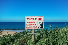 Sign that warns about the danger ahead of dubbed the Hebrew inscriptions. Sign that warns about the danger ahead stock image