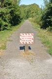 Sign Warns of Extreme Fire Hazard. Vertical view of an outdoor sign stating that the path is closed due to an extreme fire hazard royalty free stock photos