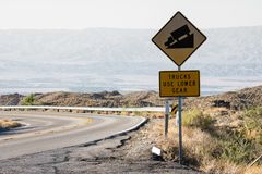Sign warns trucks to use lower gear on the steep, winding Palm to Pines Highway. In Southern California stock image