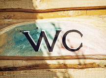 Sign WC on the wooden background Royalty Free Stock Image