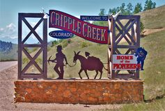 Welcome Sign in Cripple Creek Colorado. A sign welcomes visitors to the mining town of Cripple Creek, Colorado, home of CC&V Gold Mine outside of Cripple Creek Stock Photo