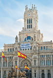 Sign welcoming refugees on City Hall of Madrid Stock Images