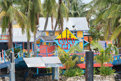 Sign welcoming visitors to the Coco Cay Island. COCO CAY, BAHAMAS - OCT 16, 2016: Sign welcoming visitors to the colorful Coco Cay island with palm trees and Royalty Free Stock Images