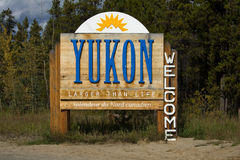 Sign welcoming visitors to the Yukon. Along the Alaska Highway, Canada stock photography