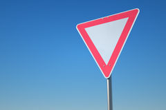 Sign. White & red road sign  on blue background Stock Photos