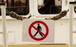 A sign who say No entry for bad people on some commercial boat royalty free stock image