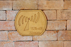 Sign Wi-fi zone. On the brick Stock Photo