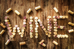 Sign wine made from corks on old wooden vintage table Royalty Free Stock Image
