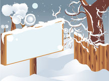 Sign in wintry countryside. Black sign or billboard in snowy winter countryside Stock Photography