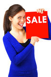 Sign woman. Beautiful mixed race asian / caucasian woman smiling holding sale sign. Isolated on white background Stock Photography