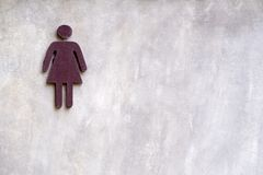 Sign of woman toilet on concrete wall. Sign of woman toilet on concrete wall for woman Royalty Free Stock Photos