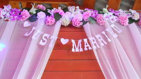 Sign on a wooden background saying just married stock footage
