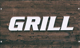 Sign on wooden table grill.  royalty free stock images