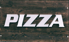 Sign on wooden table pizza.  vector illustration