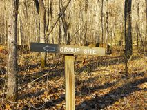 Sign Pointing to Group Campsite. Sign in the woods directing group campers to a specific area stock photos