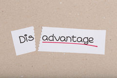 Sign with word disadvantage turned into advantage. Two pieces of white paper with the word disadvantage turned into advantage Stock Photo