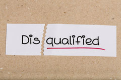 Sign with word disqualified turned into qualified Royalty Free Stock Photos