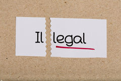 Sign with word illegal turned into legal Royalty Free Stock Photos