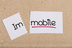 Sign with word immobile turned into mobile Stock Image