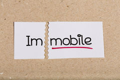 Sign with word immobile turned into mobile Stock Photos
